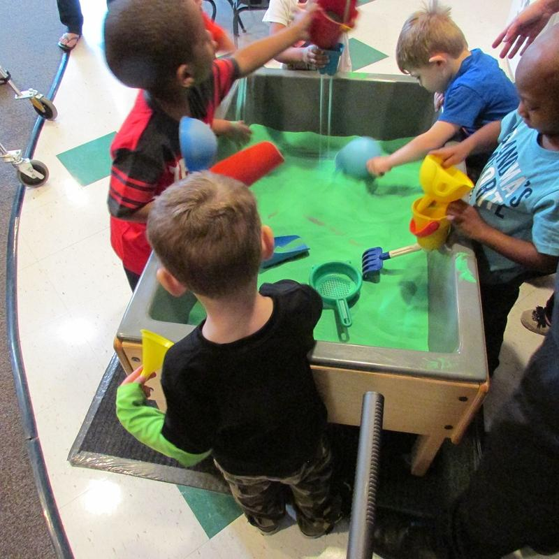 Pre-schoolers playing at a table.
