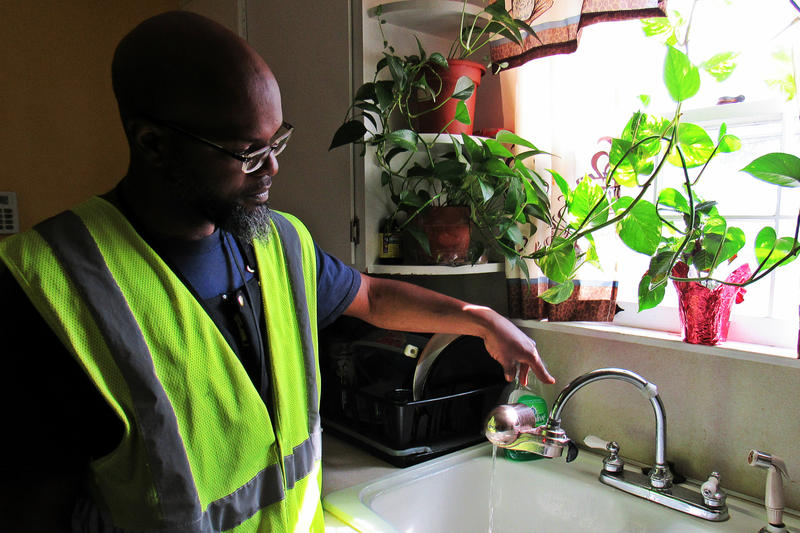 CORE team member Aaron Gates says the flashing red light on this water filter means the cartridge needs to be changed.