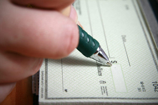 A person writing a check