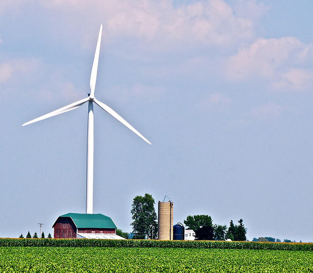 A wind turbine above a barn