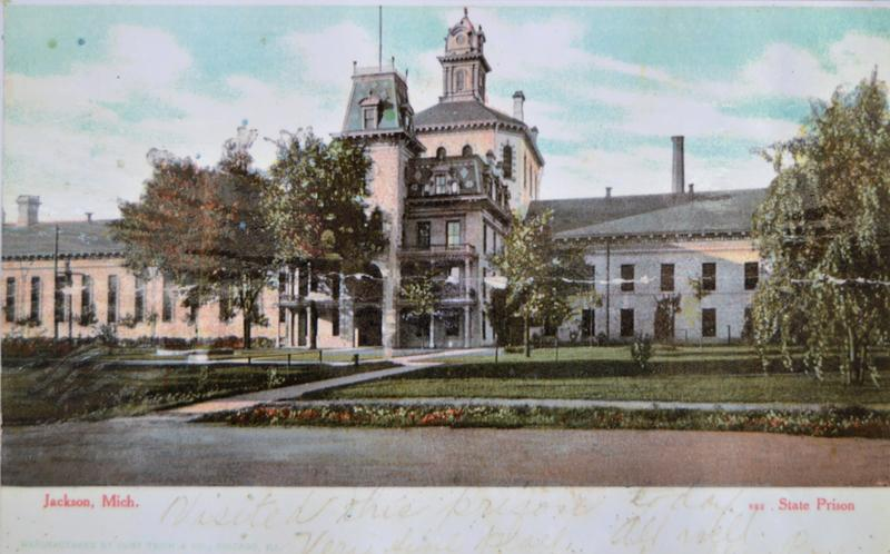A postcard (circa 1900) shows the administration building in the center.