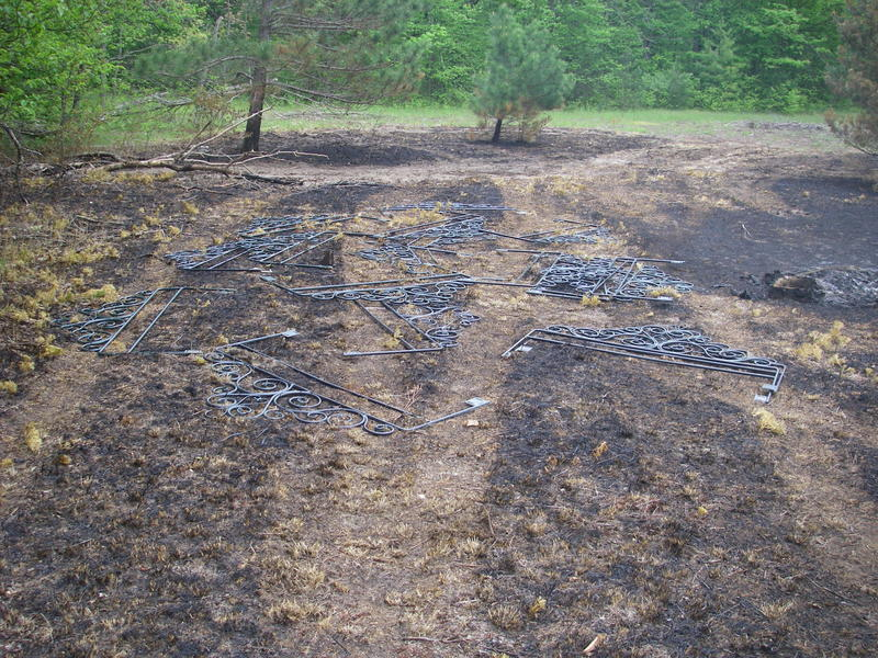 Several of the headboards found burned near the village of Lake Ann in Benzie County.
