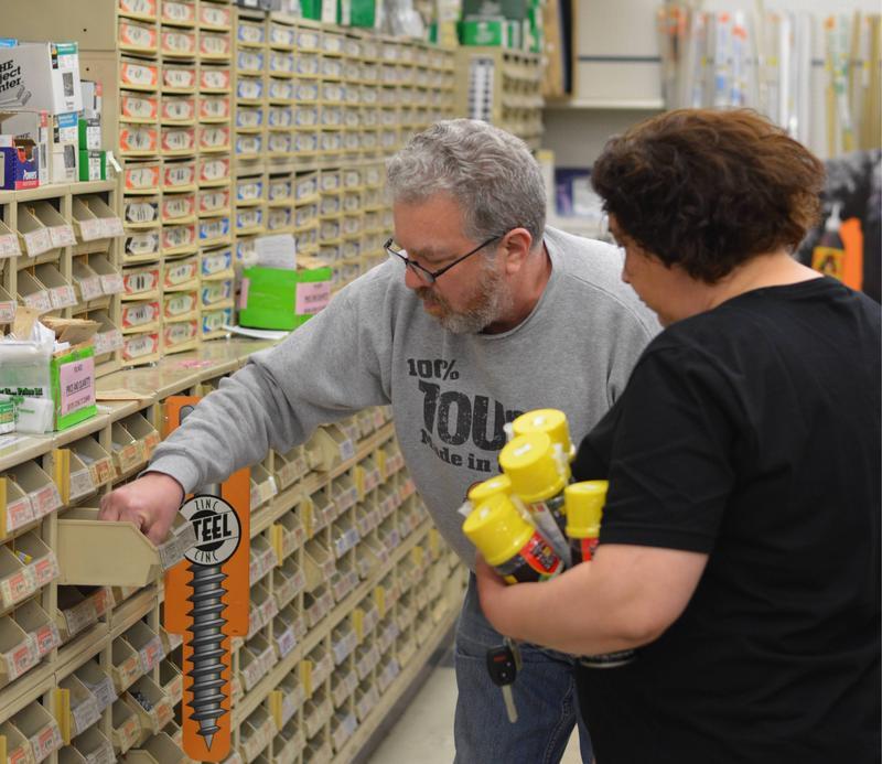 Hammer Time owner, Bill Kamman, helping a customer.