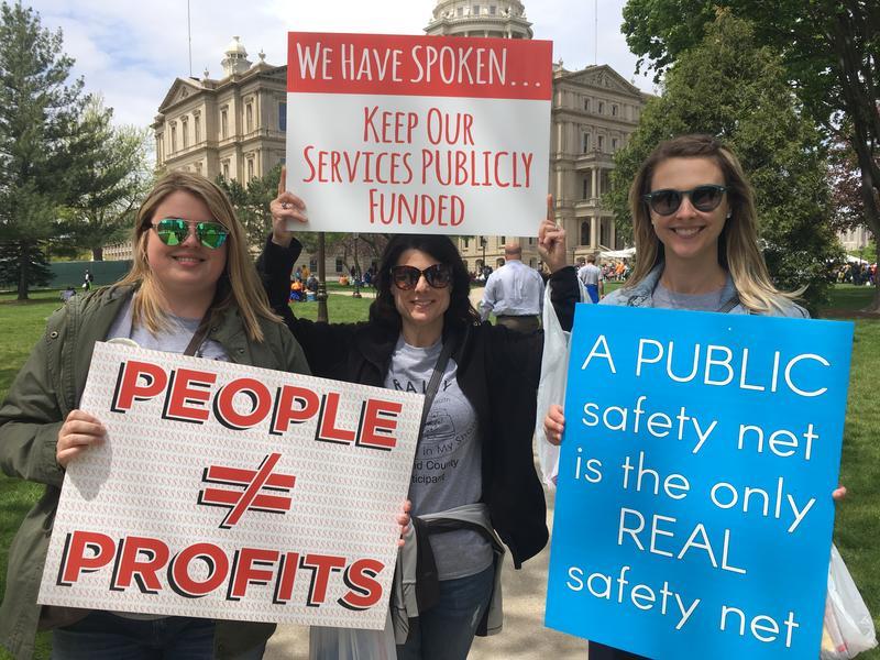 Mental health administrators Nicole Lawson, Christina Nicholas, and Jillian Trumbell demonstrate at the Michigan Capitol