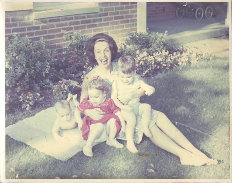 Rosalie Edwards sits on a picnic blanket with her small children in 1963.