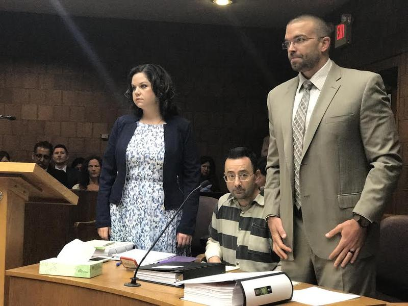 Larry Nassar, center, flanked by his defense attorneys, Shannon Smith (left) and Matt Newburg