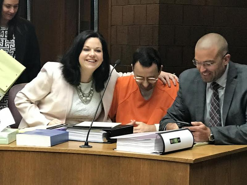 """I feel like we should say 'cheese,'"" attorney Shannon Smith, left, joked on Friday. Larry Nassar is center, and attorney Matthew Newburg is on the right."