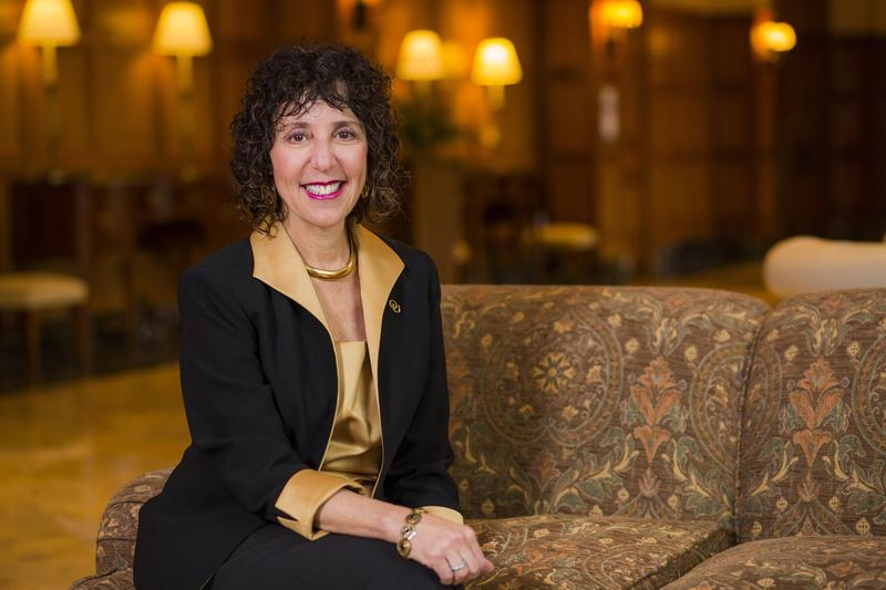 Incoming Oakland University president Ora Hirsch Pescovitz sitting on a chair