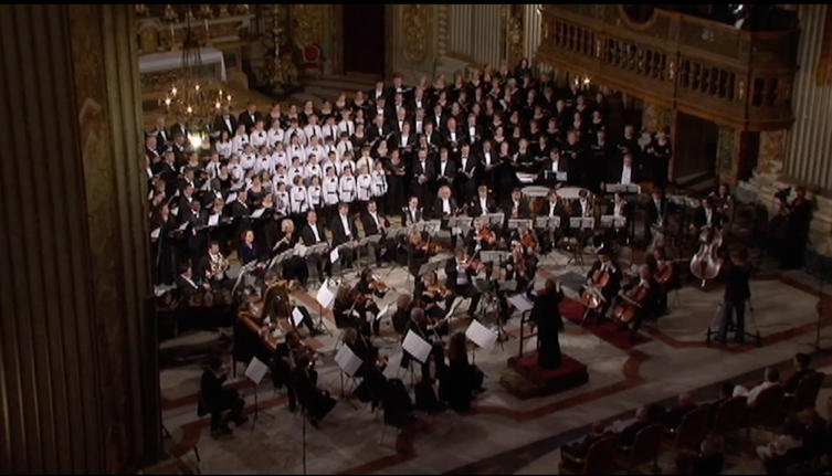 The orchestra and choirs on stage the day of the performance in Rome.