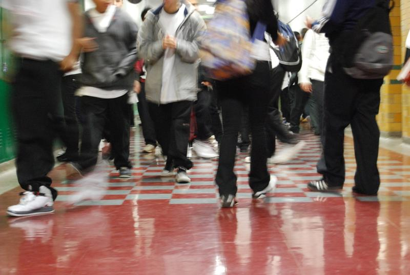 kids walking in a school hallway