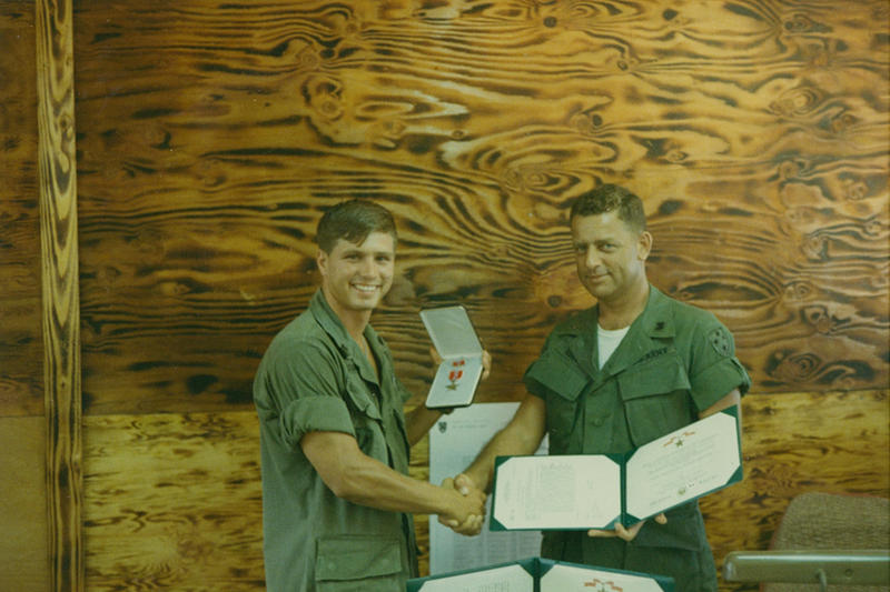 "U.S. Army Pfc. James McCloughan (left) is awarded the Bronze Star with ""V"" Device on February 10, 1970."