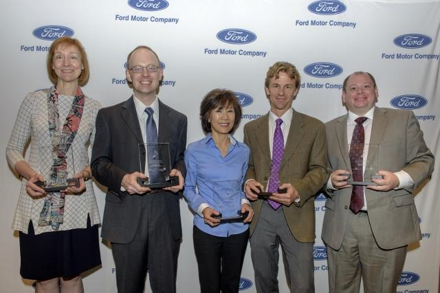Diane McElfish Helle and others holding awards