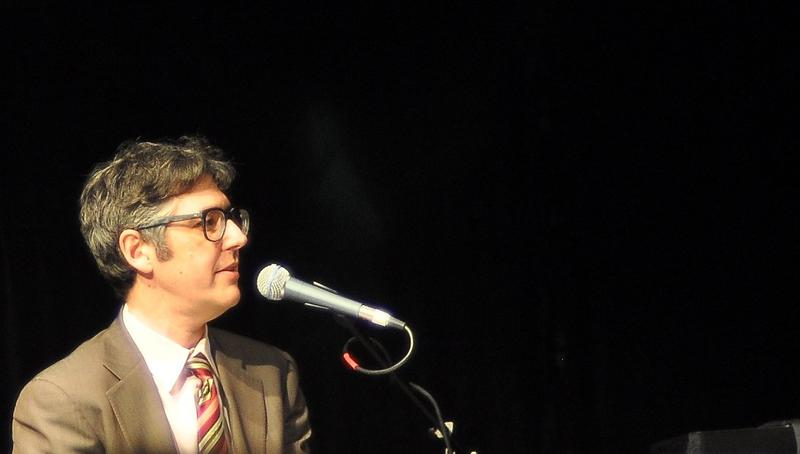 ira glass in front of microphone
