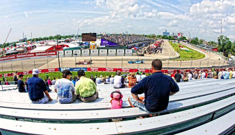 Spectators watching a car race