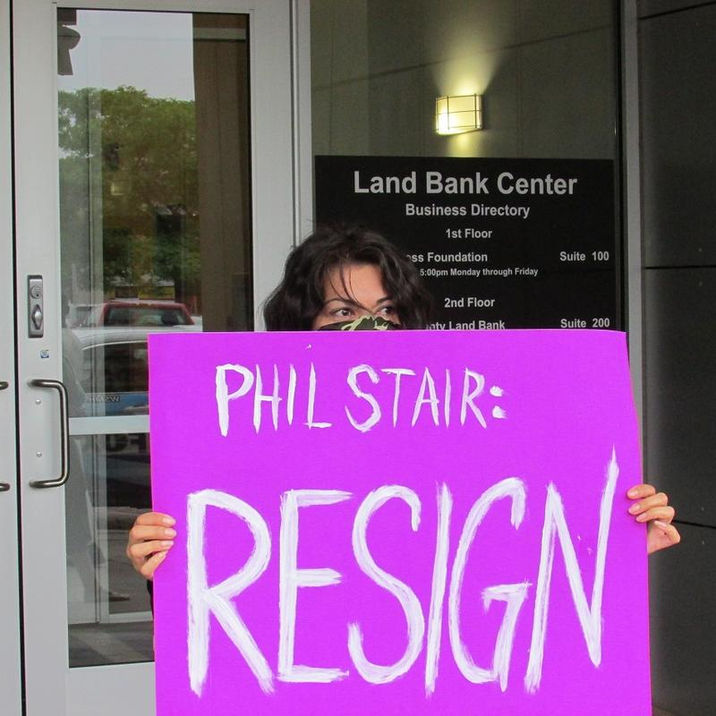 Flint resident holding protest sign again  Phil Stair.