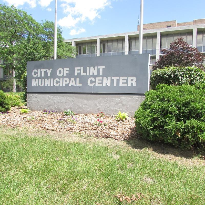 "A sign that says ""City of Flint Municipal Center"""
