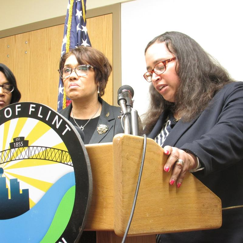 Flint Mayor Karen Weaver (left) and City Attorney Angela Wheeler respond to the city council's concern about a lack of information about GLWA deal