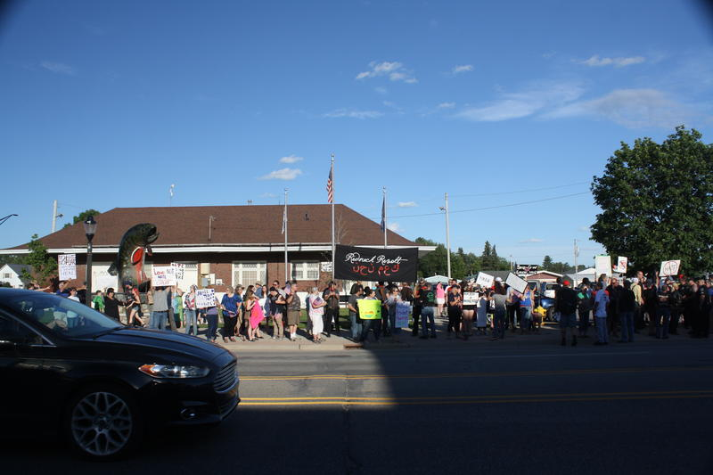 Protestors line the street in Kalkaska