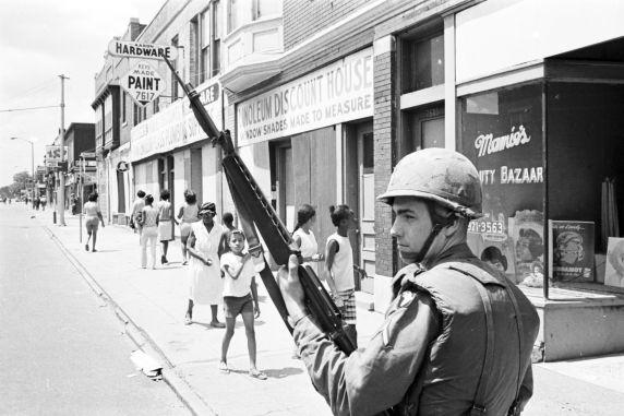 A National Guardsman patrols a Detroit street during the July 1967 rebellion.