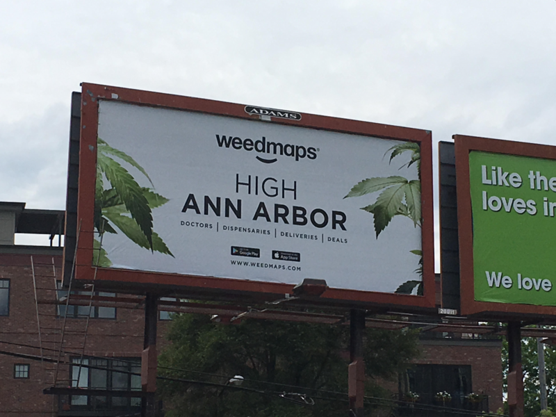 "medical marijuana billboard that says ""high ann arbor"""