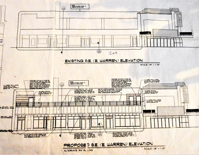 Blueprints for the planned exterior work sit on a table in the lobby of the theater.