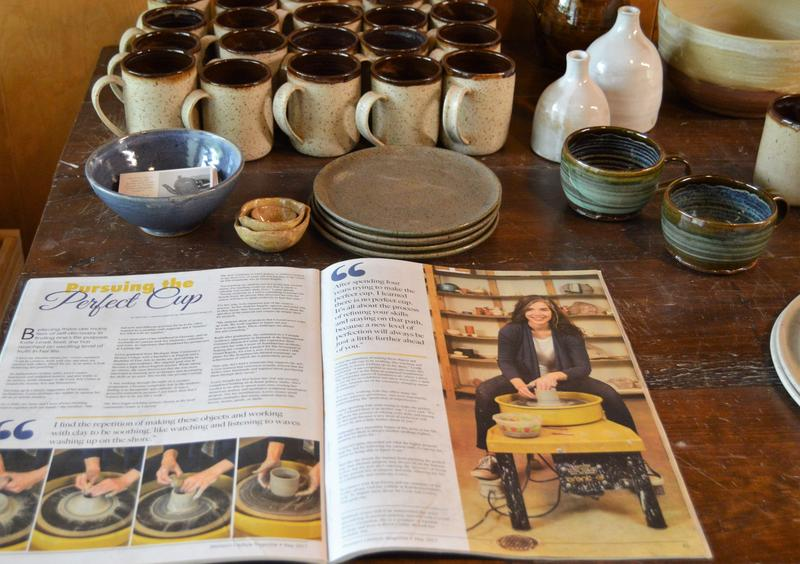 A recent article on Kate Lewis Ceramics is on display with some of her recent work in her pottery studio.
