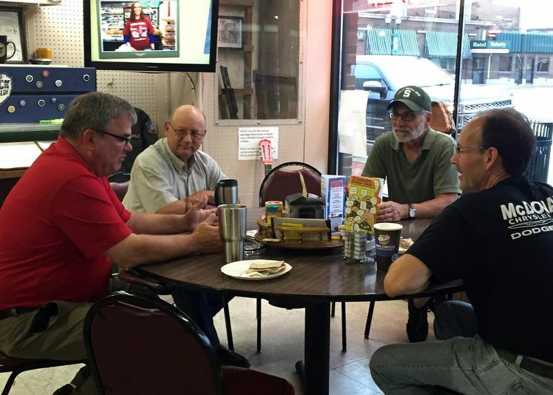 A group of retirees holds court almost every morning at Cops and Doughnuts in Clare.