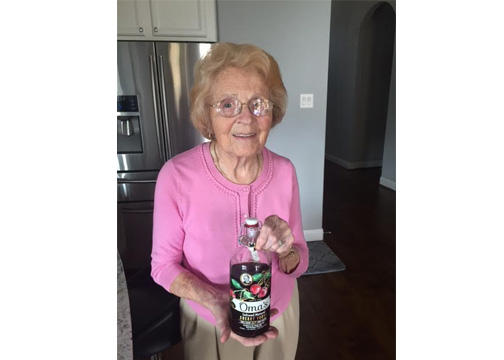 Steinbart with bottle of her vodka