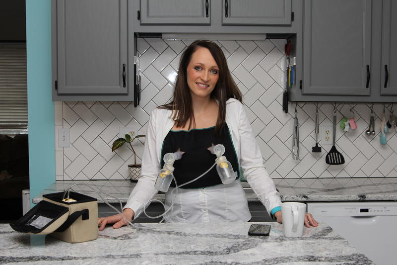 """Julie Burrell wears her """"Pumpndo"""" invention. It's a hands-free way to pump breast milk while doing other things."""