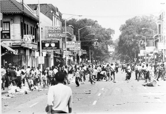 black and white photo of people rioting in downtown Detroit