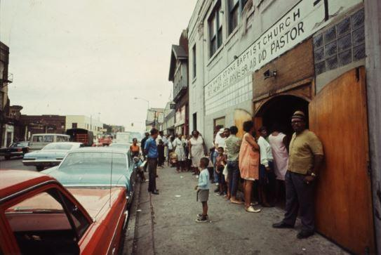 Citizens line up for food aid during the 1967 Detroit uprising.