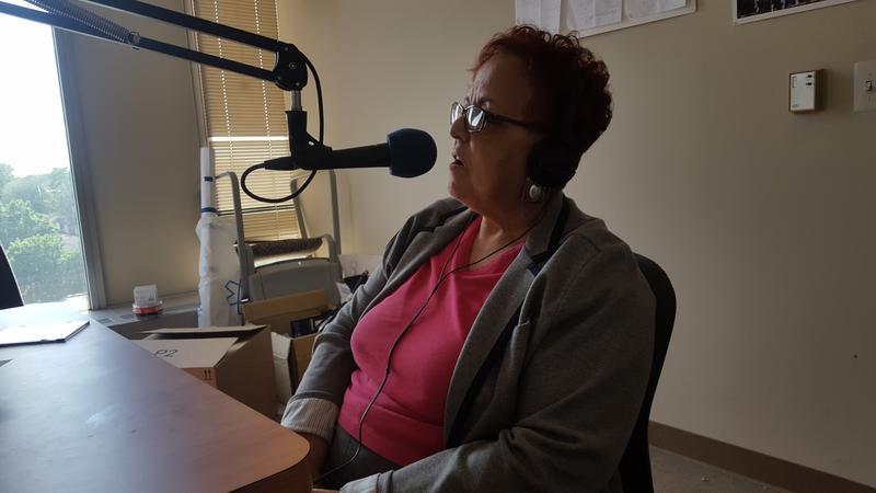 Reverend Joan Ross recording in her studio