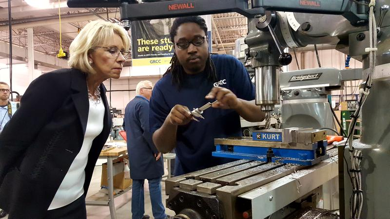 U.S. Secretary of Education Betsy Devos being shown factory equipment