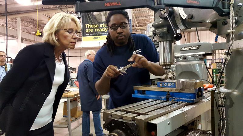 U.S. Secretary of Education Betsy Devos being shown factory equipment