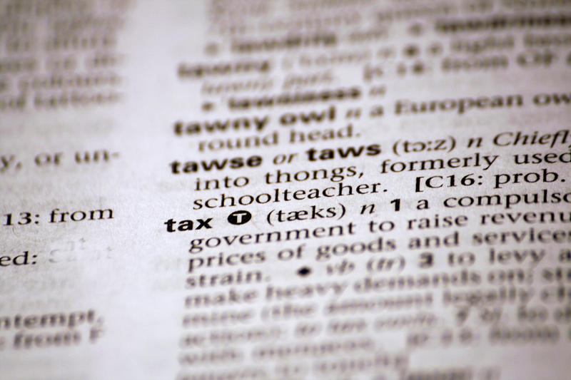 dictionary turned to the word tax
