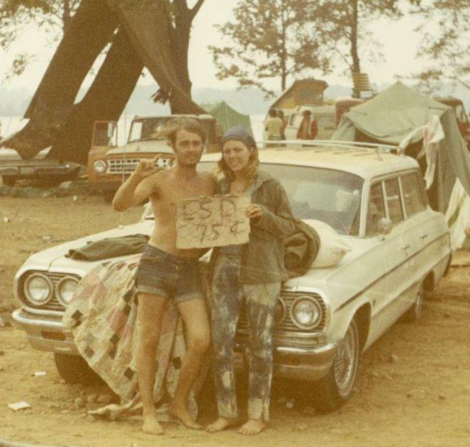 Two people sell LSD for seventy-five cents at the Goose Lake International Music Festival in 1970.
