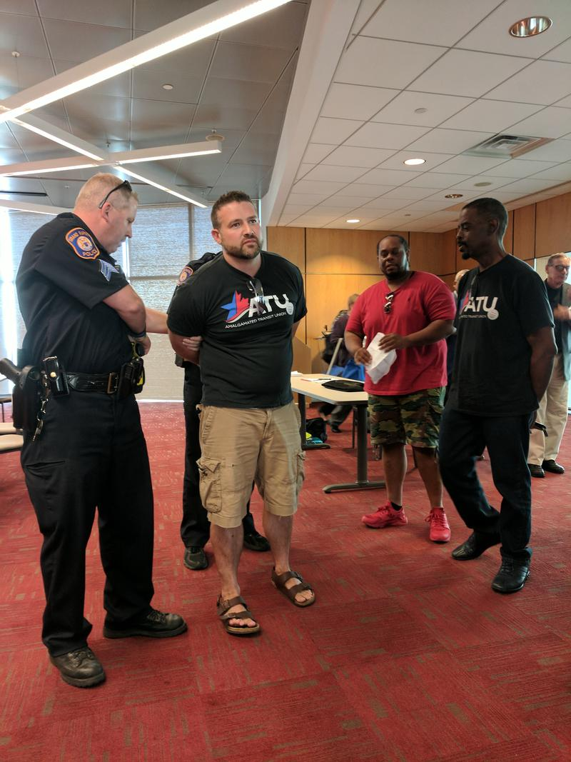 Rapid bus driver's union member being arrested at board meeting