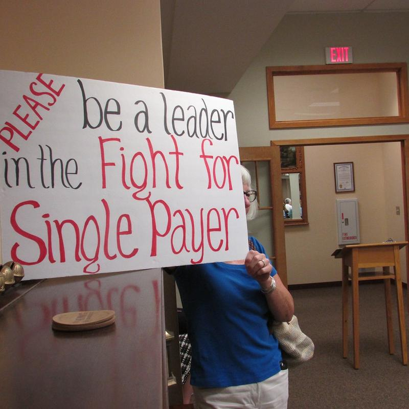 "sign that says ""please be a leader in the fight for single payer"""