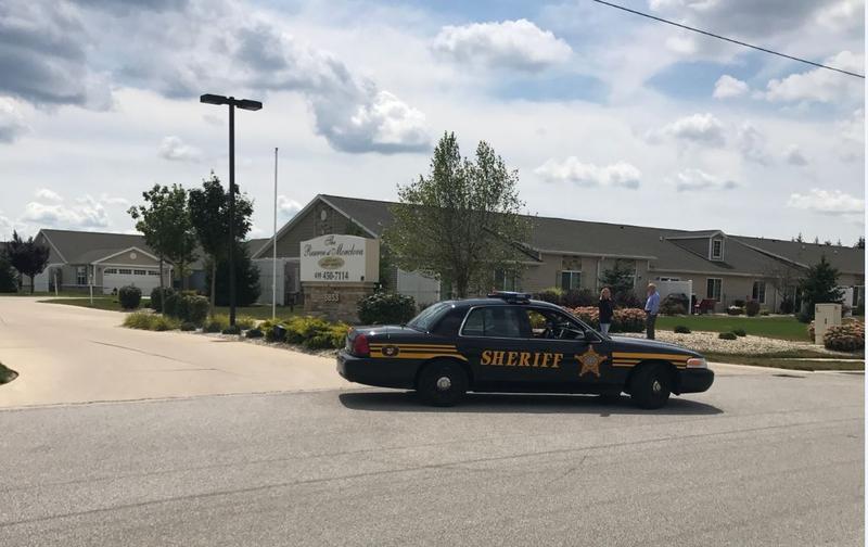 Cop Car parked sideways in a driveway
