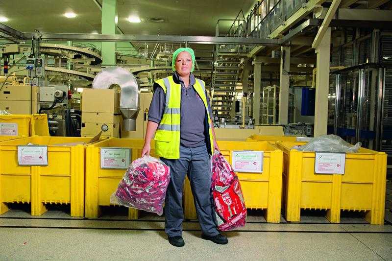 woman carrying bags on factory floor