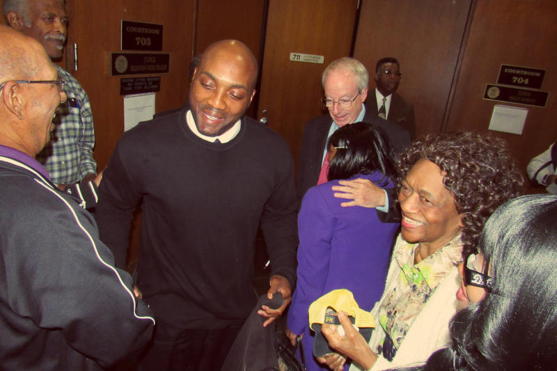 LaMarr Monson's family congratulates him after he was exonerated Friday morning.