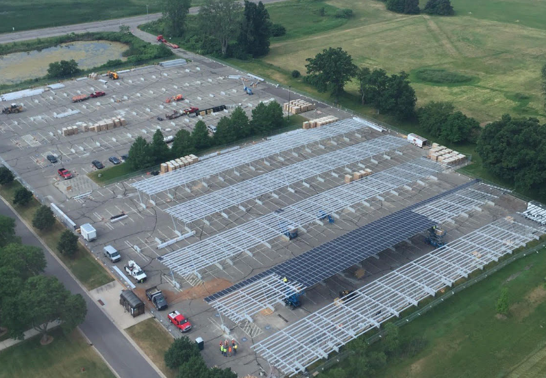 MSU is covering parking spaces with solar panels to provide shade, reduce emissions, and save money. Pictured is about 10% of the project during early construction in June.
