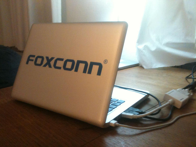 laptop with Foxconn label on it