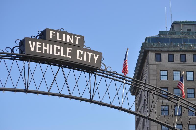 sign that says flint vehicle city