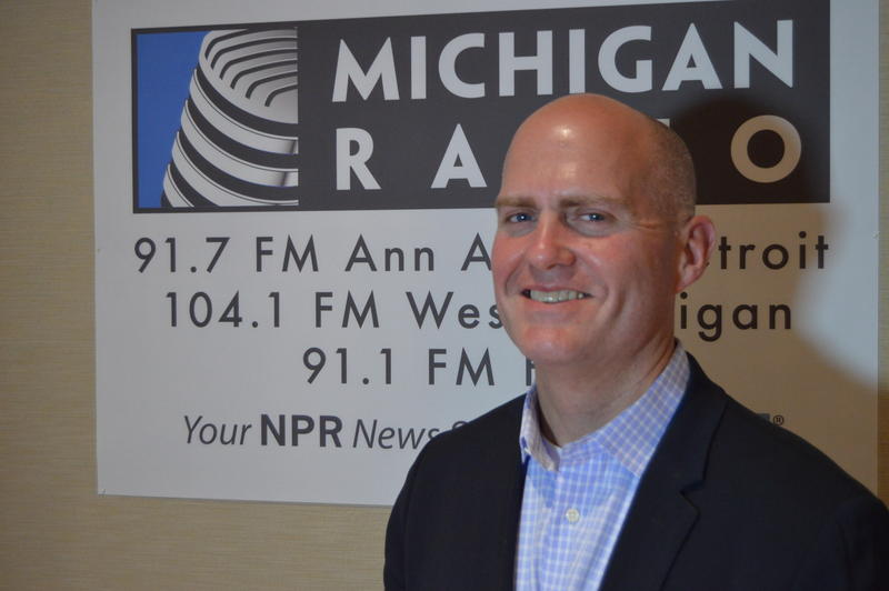 scot graden in front of michigan radio sign
