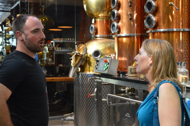 Kyle Van Strien explaining Long Road's philosophy to Tammy Coxen.