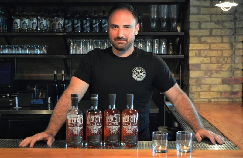 "Kyle Van Strien with the ""Beer City Whisky"" lineup."
