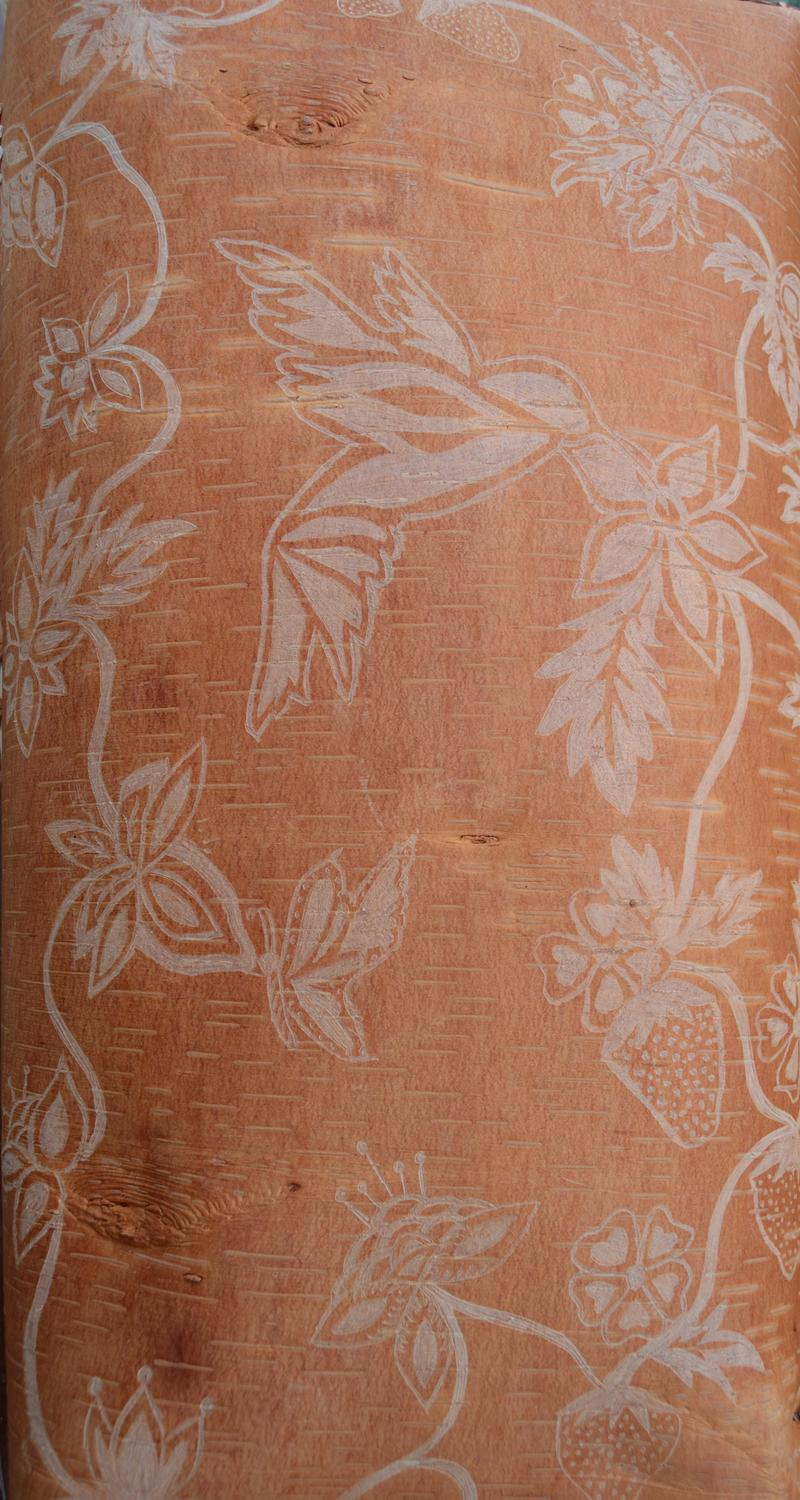 flowers etched into brown wood