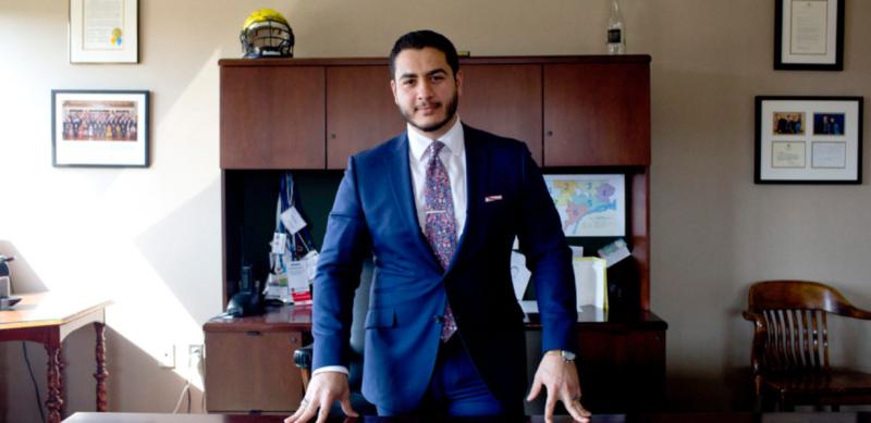 dr abdul el sayed behind a desk