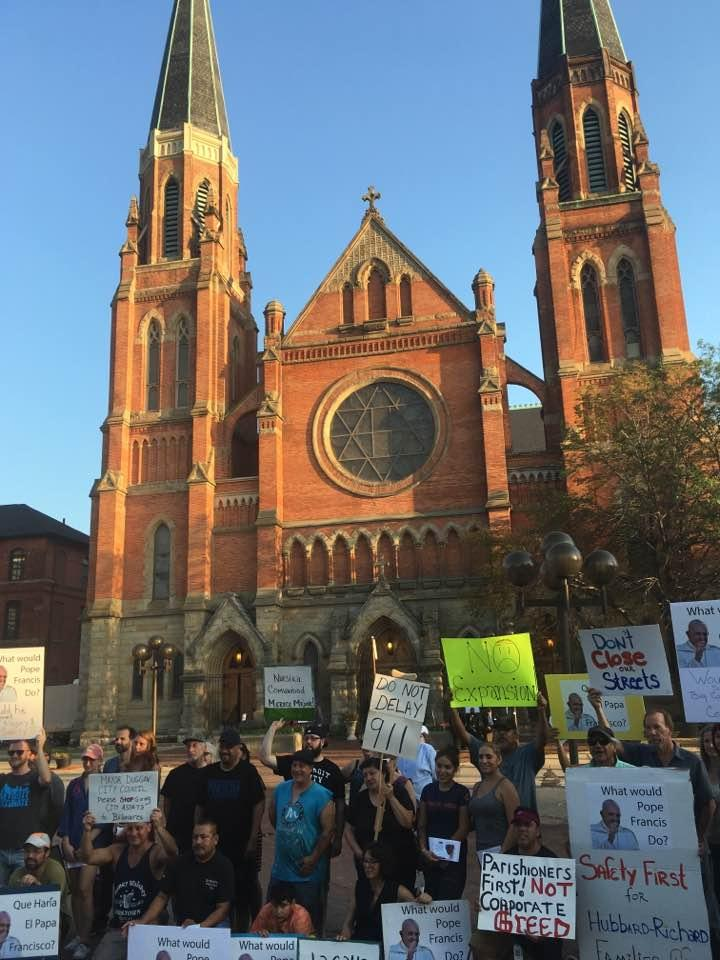 "A ""silent protest"" against the Bridge Company's proposal outside St. Anne's Catholic Church."